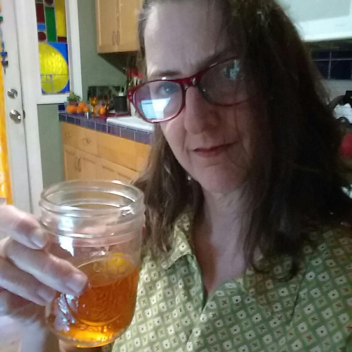 Izzi raising a toast and wishing you a good hour or two